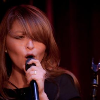 Singer/Sax Player Ms. Evelyn Rubio Takes Europe By Storm